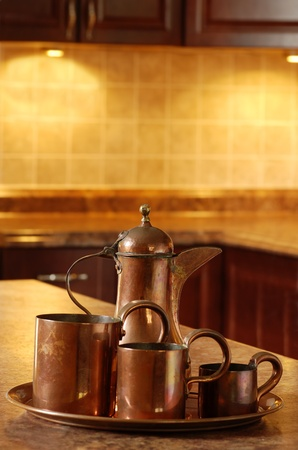 old copper in kitchen focus on jug