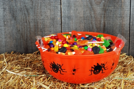 bowl of halloween candy on straw photo