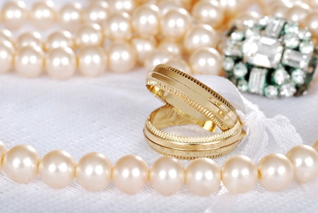 diamond earrings: gold wedding bands with pearls