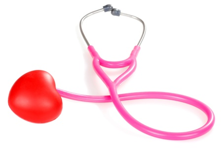 Pink stethoscope with red heart Stock Photo