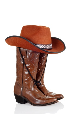 brown leather hat: cowboy boots and hat