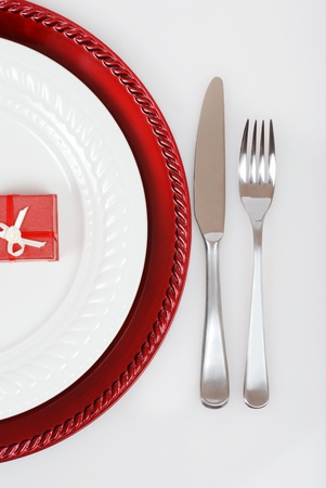 dinnerware: Christmas place setting with present Stock Photo