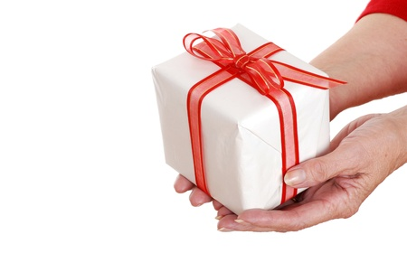 Senior woman hands holding christmas gift