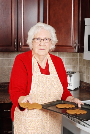 senior woman with gingerbread snowman photo