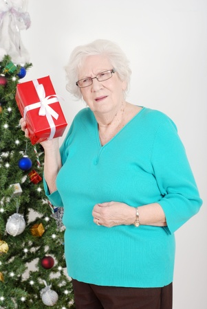 guessing: Senior woman guessing her christmas gift