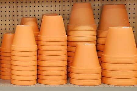 stack of clay pots on a shelf photo