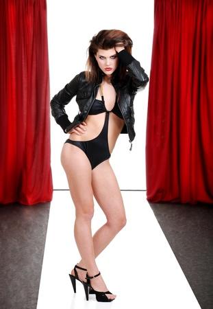 drape: woman model in bathing suit on the catwalk