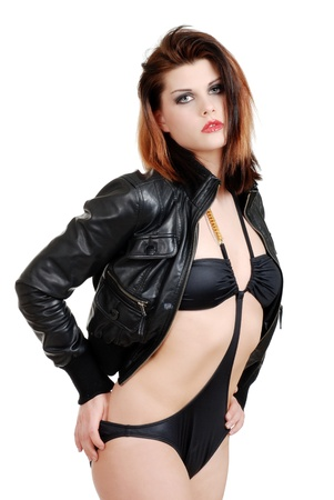 Sexy model posing in swimsuit with leather jacket photo