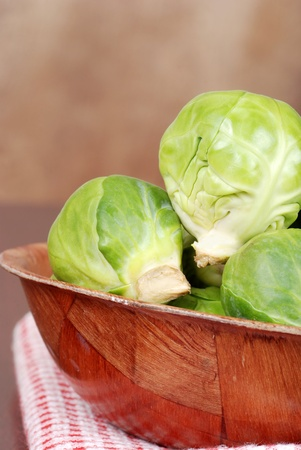 Brussel sprouts in wood bowl Stock Photo - 12043658