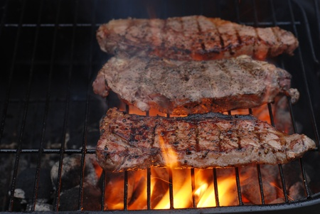 Strip loin  steaks on the barbecue photo