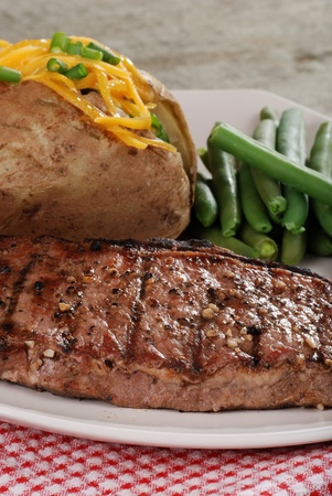 Closeup barbecue strip loin steak photo