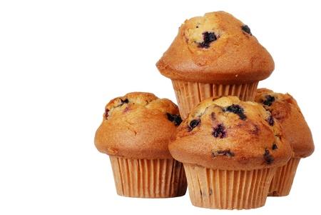 Geïsoleerde stapel bosbessen muffins Stockfoto