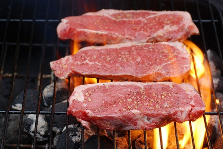 barbecuing: Barbecuing strip loin steaks