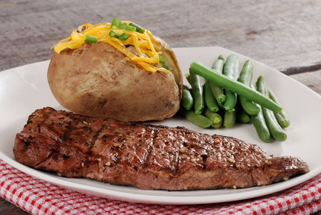 closeup barbecue steak with vegetables photo