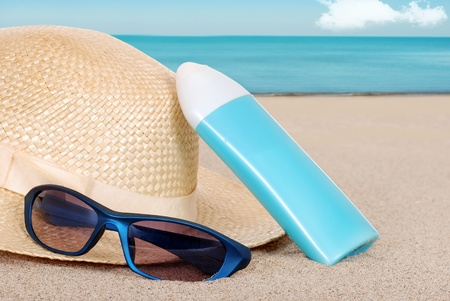 suntan lotion hat focus on sun glasses photo