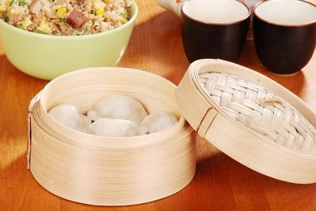 Asian dumpling in bamboo basket photo