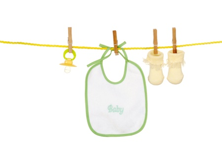 Isolated baby bib socks on a clothes line photo