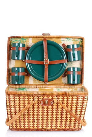 basket: open picnic basket with green plates