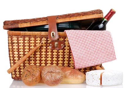 basket: Picnic basket with bread cheese and wine Stock Photo