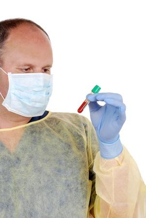 labratory: Doctor examining test tube of blood Stock Photo