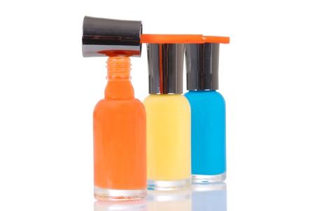 nail polish bottle: Orange nail polish brush on bottle Stock Photo