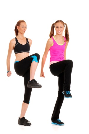 Two women doing zumba fitness photo