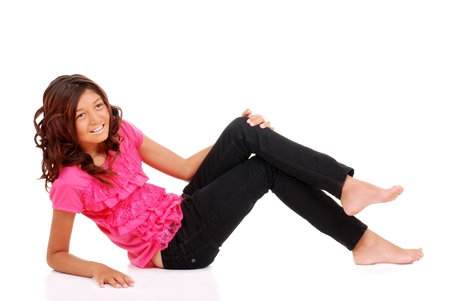 Young girl laying down with pink top photo