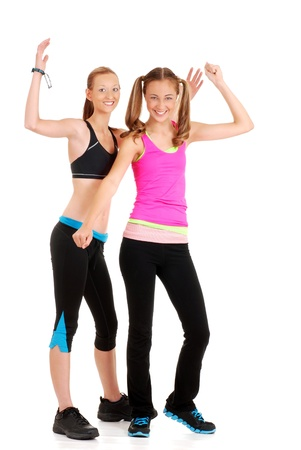two young women doing zumba fitness photo