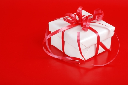 White christmas gift with red ribbon photo