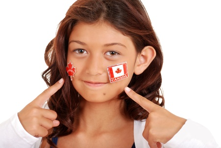 canada day: young girl with Canada day stickers on face Stock Photo