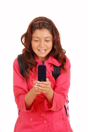 Young girl texting on cell phone photo