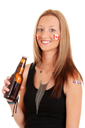 canada day: Young woman celebrating canada day with beer