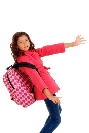 School girl struggling heavy backpack