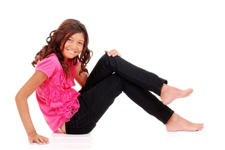 Gelukkig jong meisje zitten Stockfoto