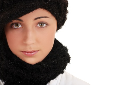 Portrait teen with winter hat and scarf photo