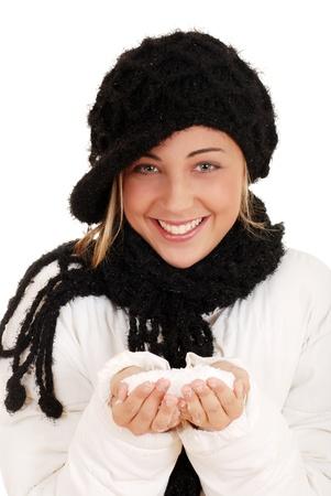 Happy teen girl with snow photo