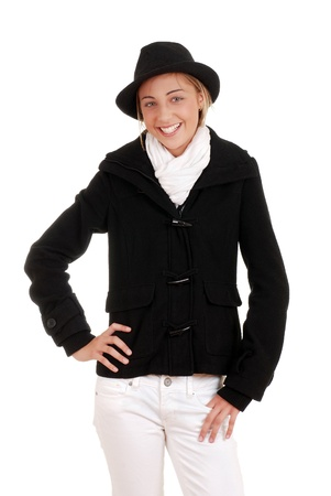 Teen girl with black winter coat and hat photo