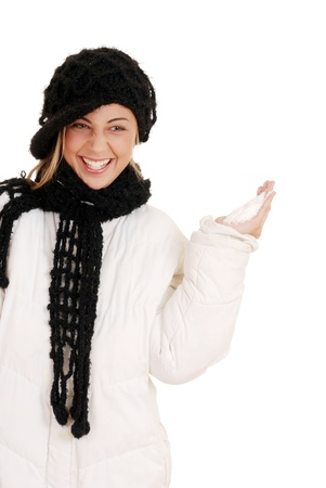Young teen girl ready to throw snow photo