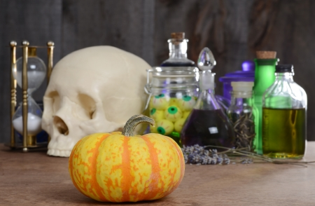 halloween still life with pumpkin and potions photo