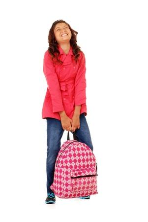 バックパック: 重いバックパックで苦労している学校の少女子