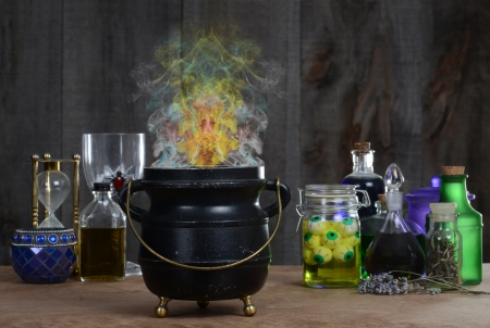 Witch cauldron with smoke photo