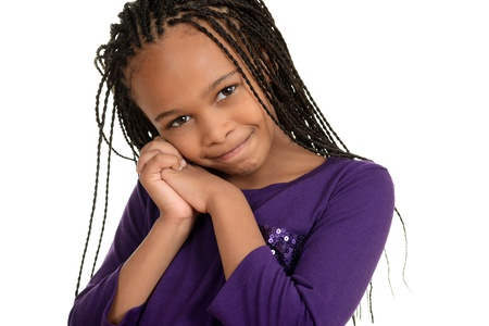 plait: cute african child with purple top Stock Photo
