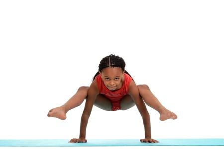 the gymnast: Young girl doing gymnastics move Stock Photo