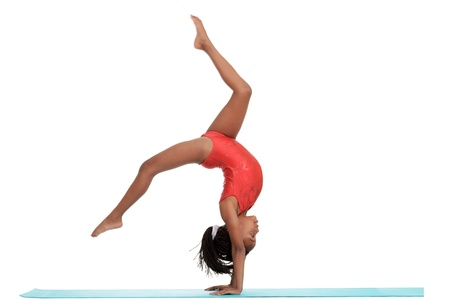 female gymnast: young girl doing gymnastics with motion blur