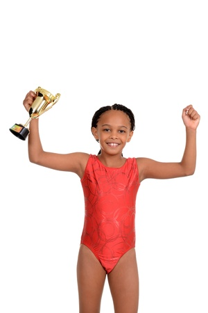 Young girl with gymnastics trophy photo