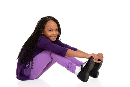 cornrows: Happy young girl wearing purple sitting