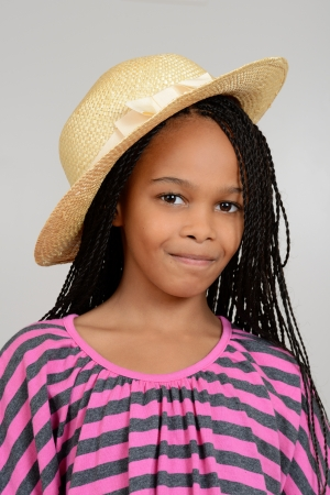 cornrows: Young african girl wearing a straw hat Stock Photo