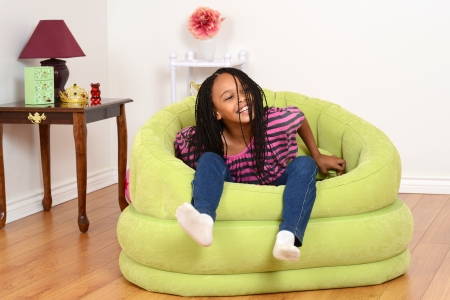 cornrows: Young black child trying to get out of chair