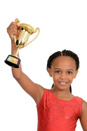 Young black child with gymnastics trophy photo