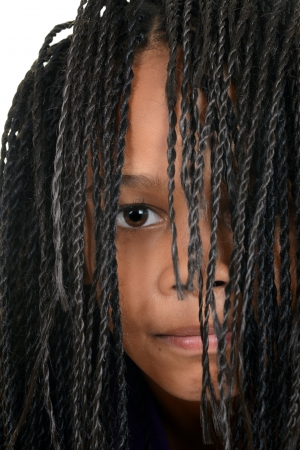 cornrows: young black girl with Cornrows over face Stock Photo